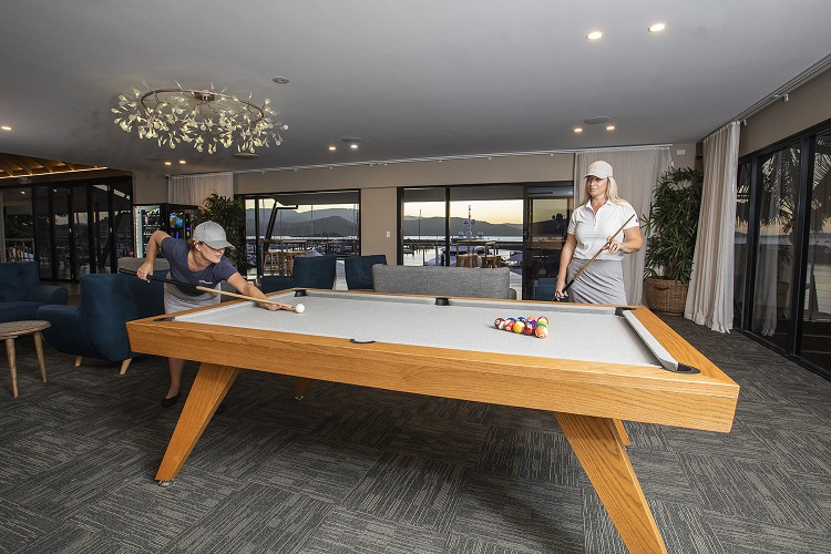 CSMR staff playing pool in the guest lounge
