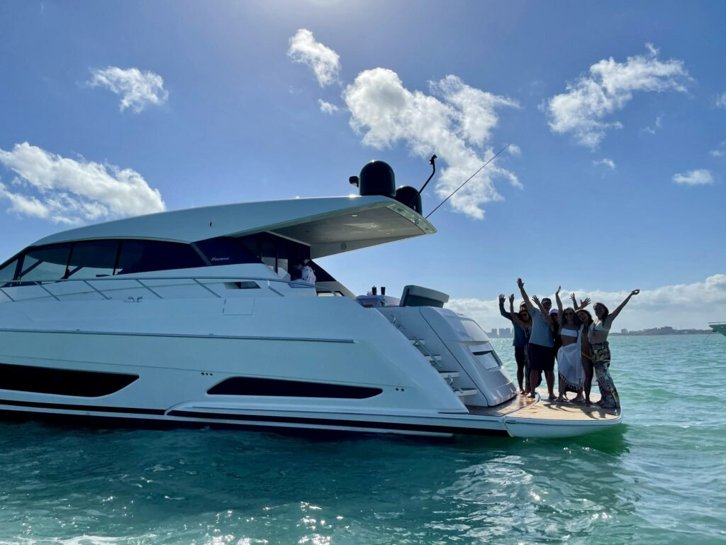 Owners of the new maritimo X6- X-Series Sports Yacht pictured onboard their new vessel