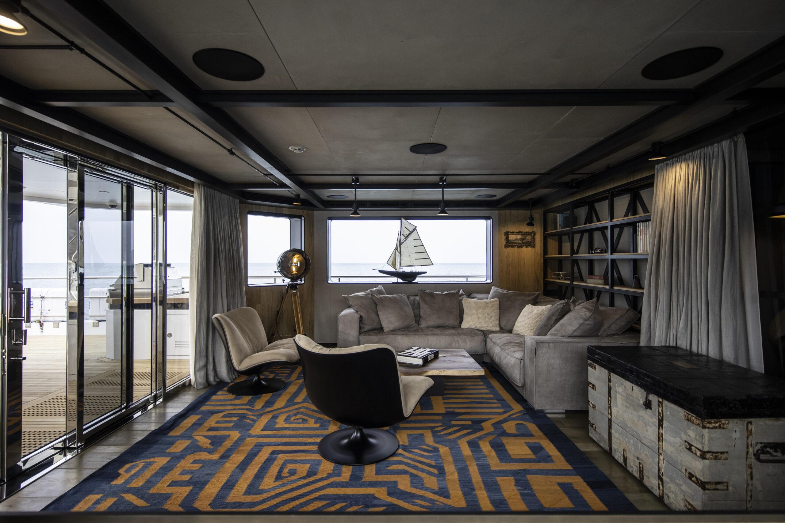 bohemian interior living area aboard the Cantiere Delle Marche Flexplorer 130