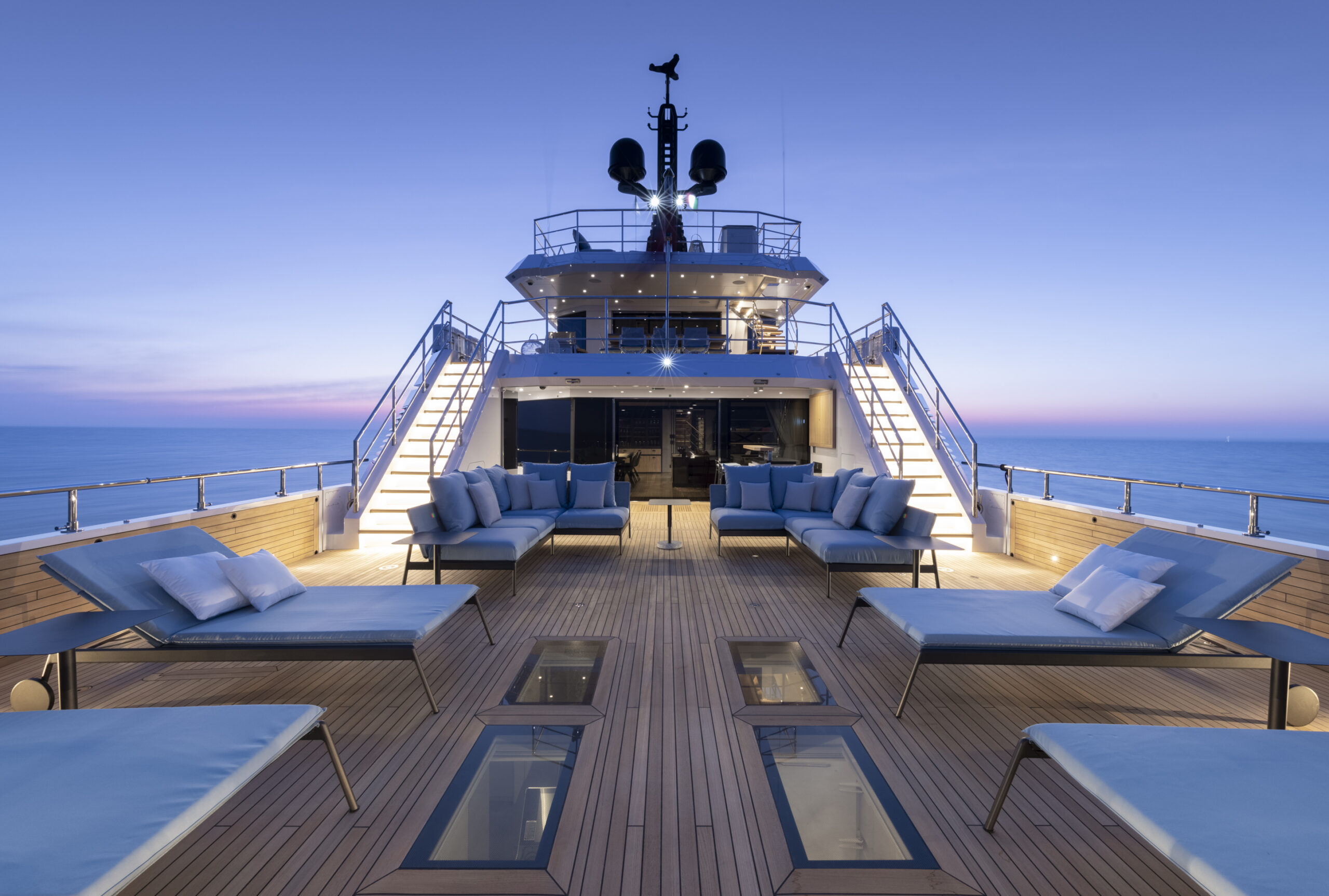 lounge deck of the Cantgiere Delle MarcheFlexplorer 130 pictured during sunset