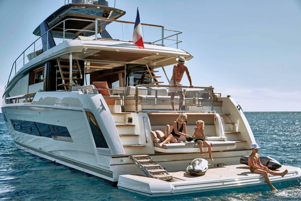 Family onboard the Prestige X70 pictured on the aft deck