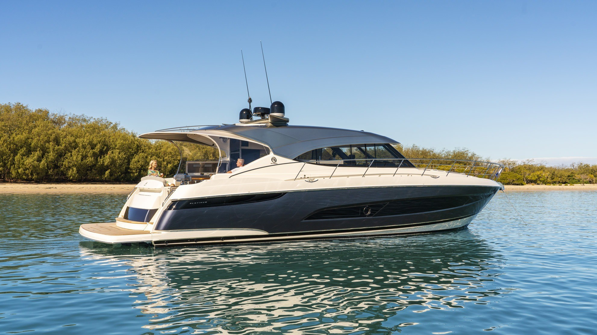 Riviera 5400 Sports Yacht Platinum edition anchored and pictured from the side