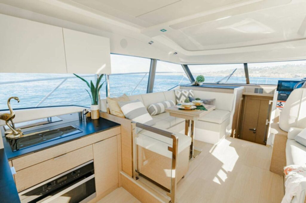 view of the light filled interior area onboard the Prestige 420S