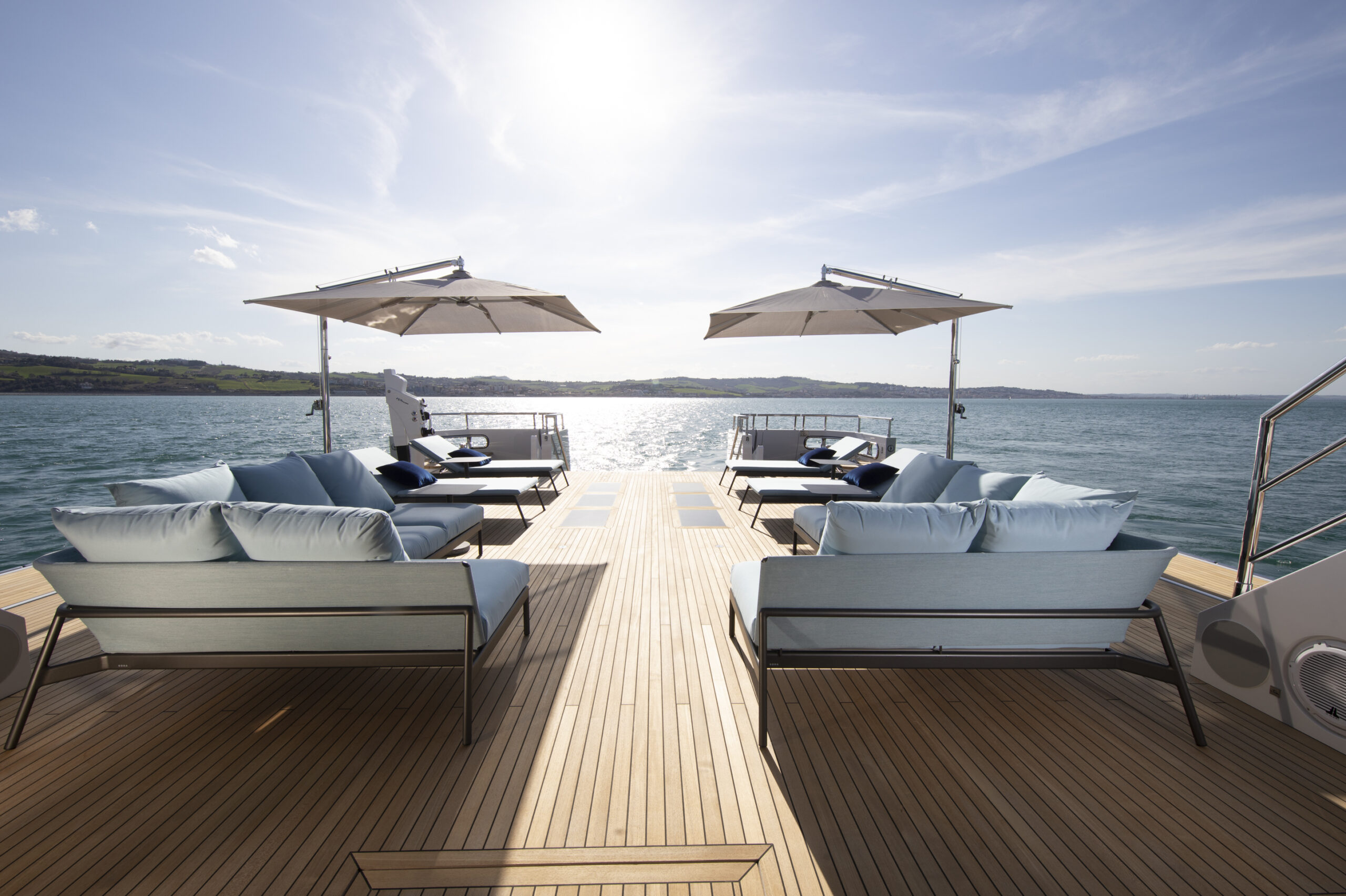 sundeck on board the Flexplorer 130 pictured with loungers in foreground and sun in background