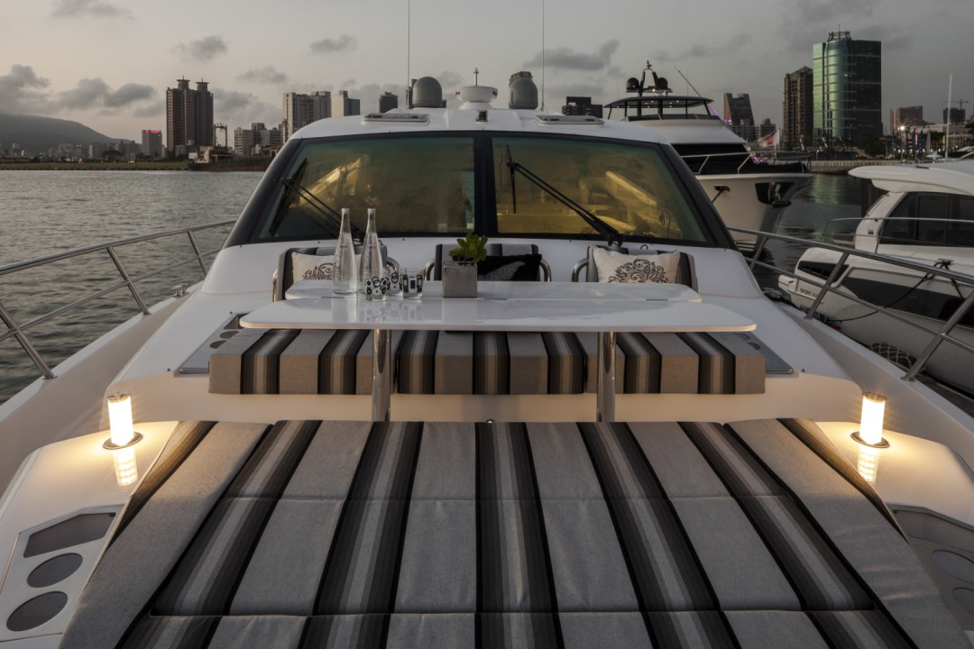 Horizon E56XO exterior lounging area with sunset in background