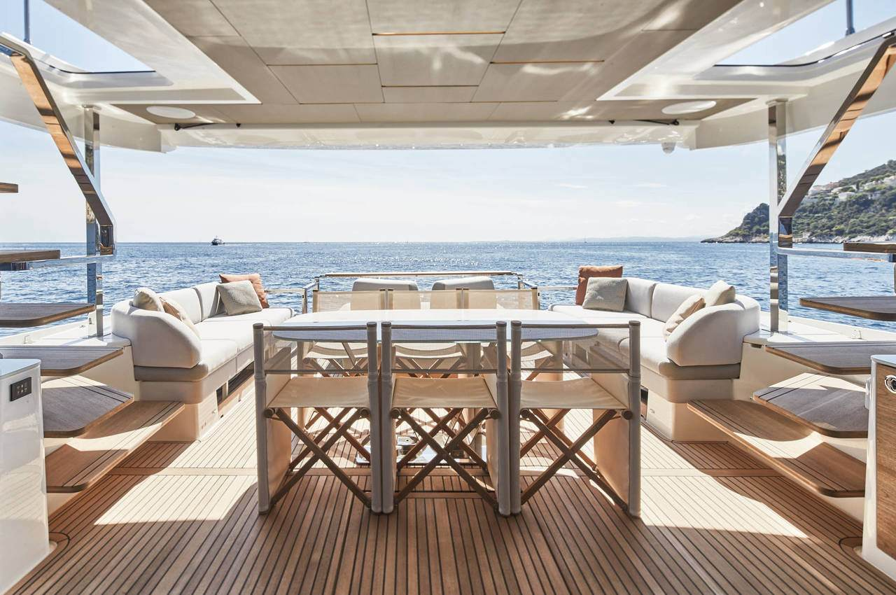 exterior dining area onboard the Prestige X70