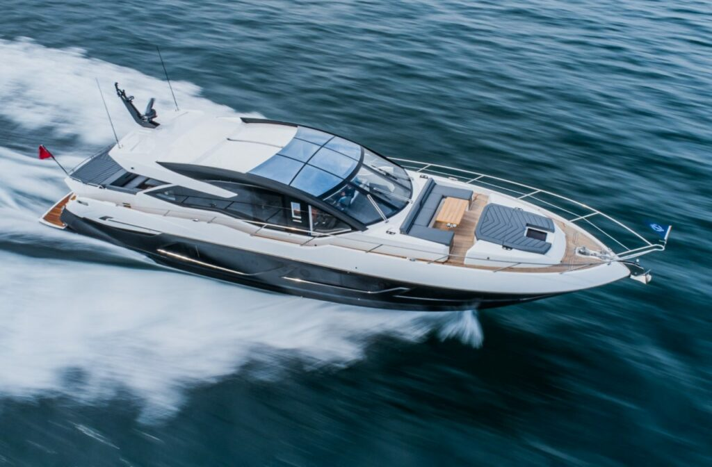 Sunseeker 74 XPS cruising from right