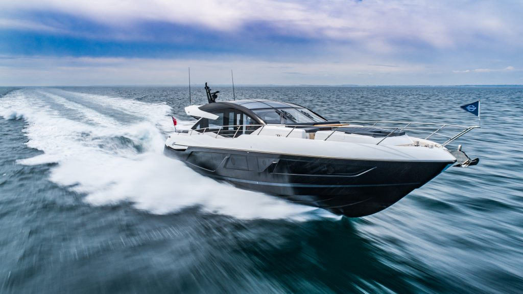 Sunseeker 74 XPS cruising and pictured from low right angle