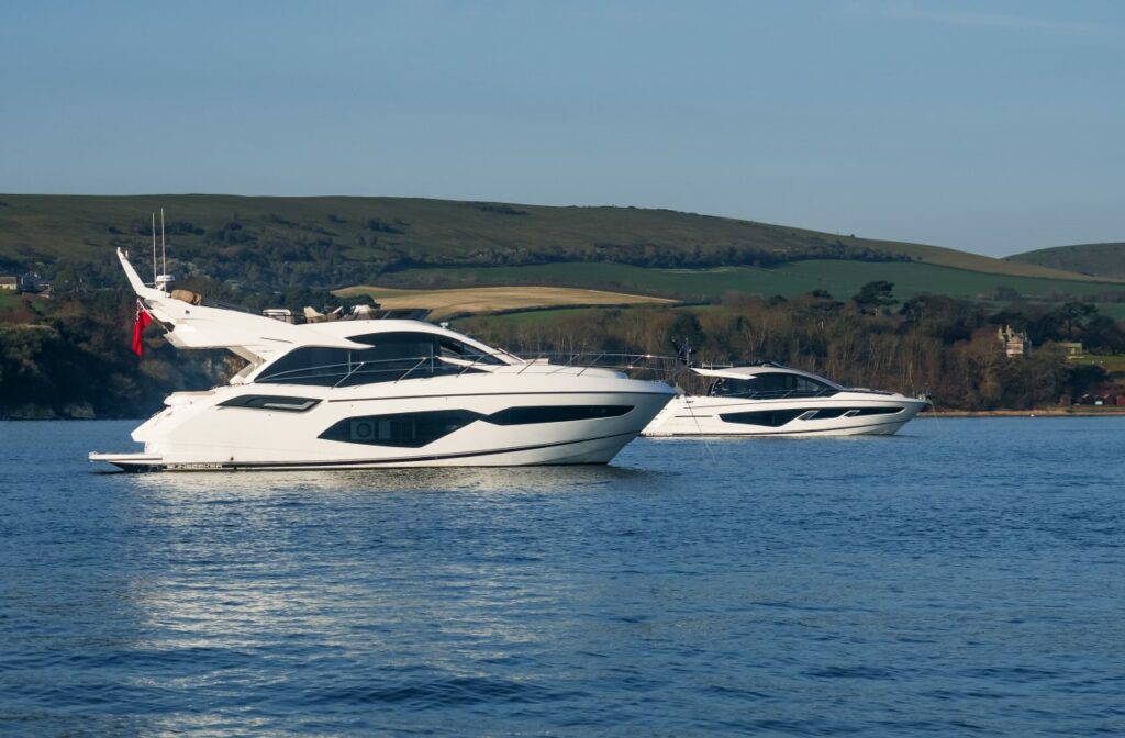 two Sunseeker boats anchored with hills in the background