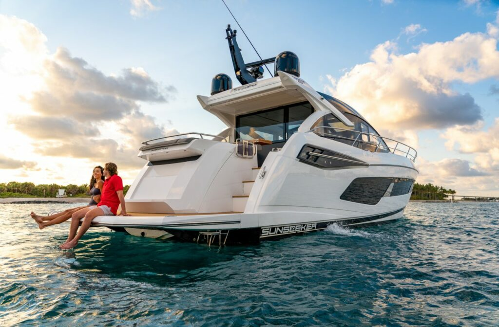 Sunseeker Predator 55 EVO from rear with two people seated on bathing platform
