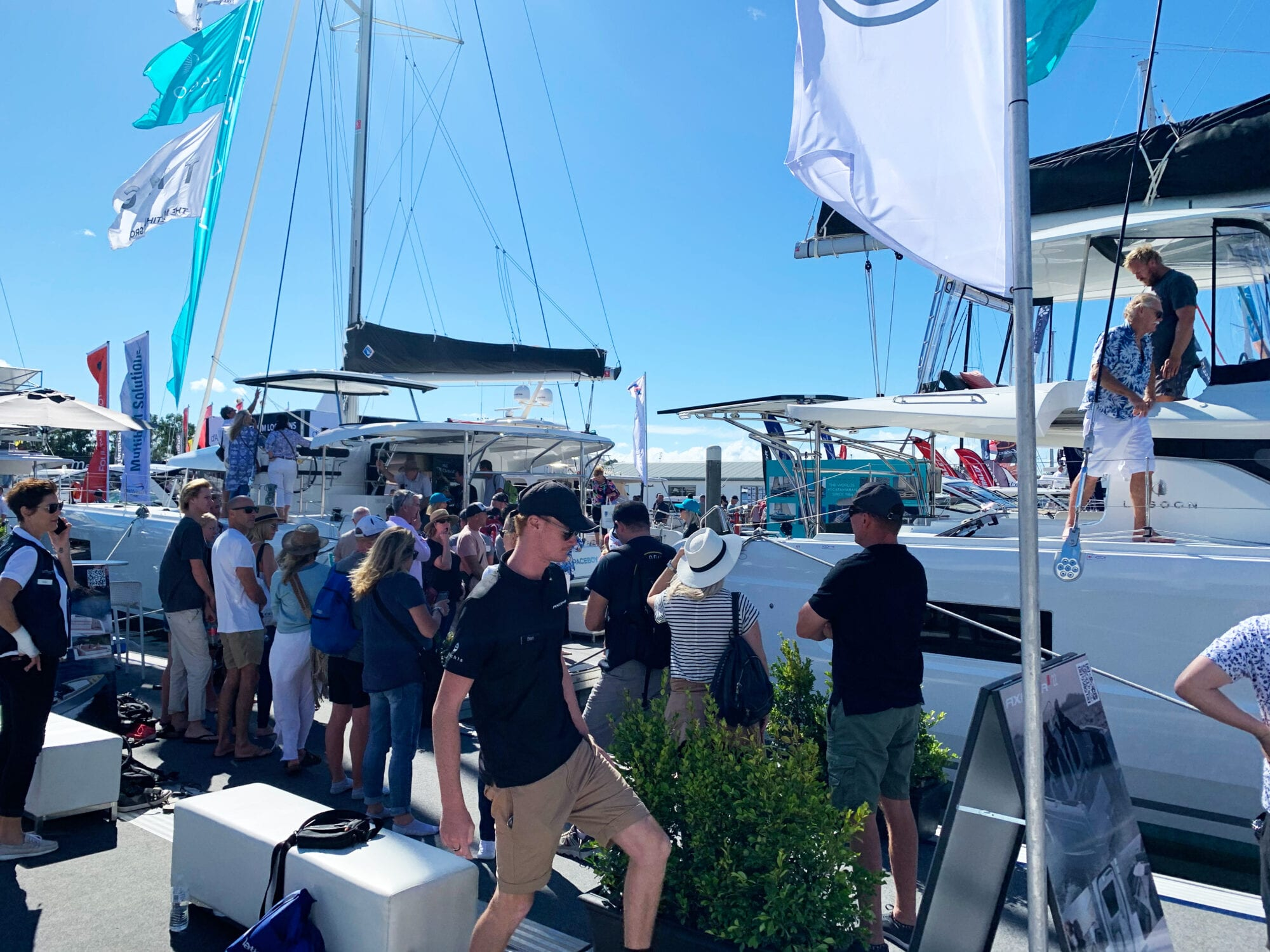 The Multihull Group stall at Sanctuary Cove with crowds of people