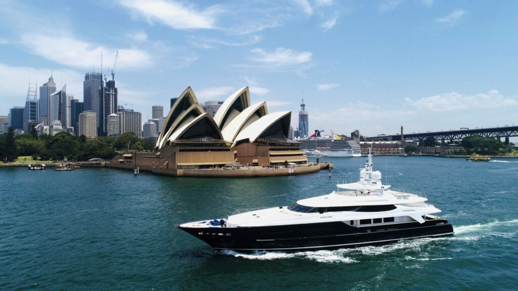 Mischief X yacht infront of the Sydney Opera House