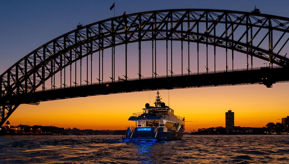 superyacht underneath the harbour bridge