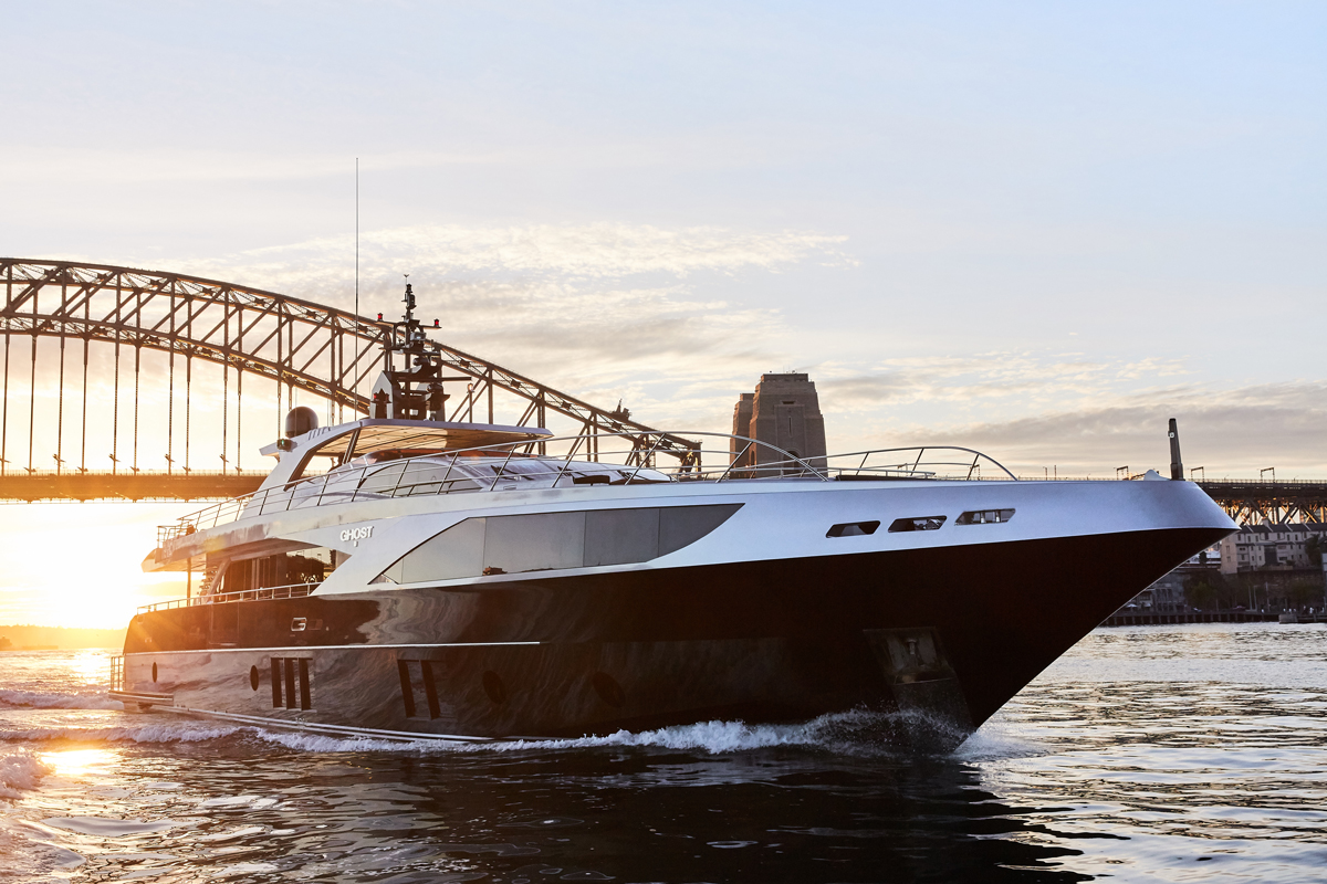 superyacht with harbour bridge in background
