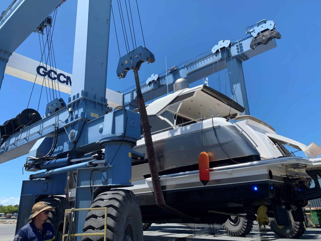 Whitehaven Yacht being lifted by crane