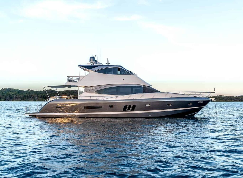 Whitehaven Flybridge 7000 anchored and pictured from the side