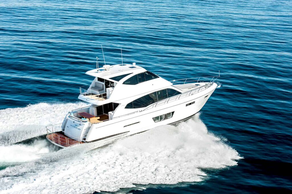 Whitehaven Flybridge 6000 pictured cruising from the rear