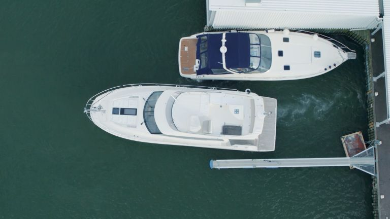 aerial shot of motor yacht docking using the assisted docking system from Volvo Penta