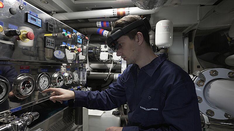 Technician onboard a Salorezo Vessel with the all new Smart Helmet on