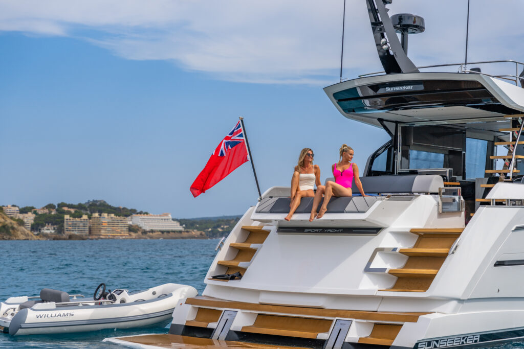 individuals lounging on back on Sunseeker 65 Sport Yacht