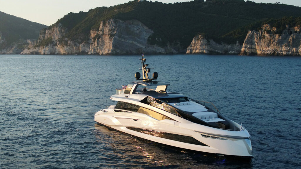 Tecnomar EVO120 anchored with cliffs in background
