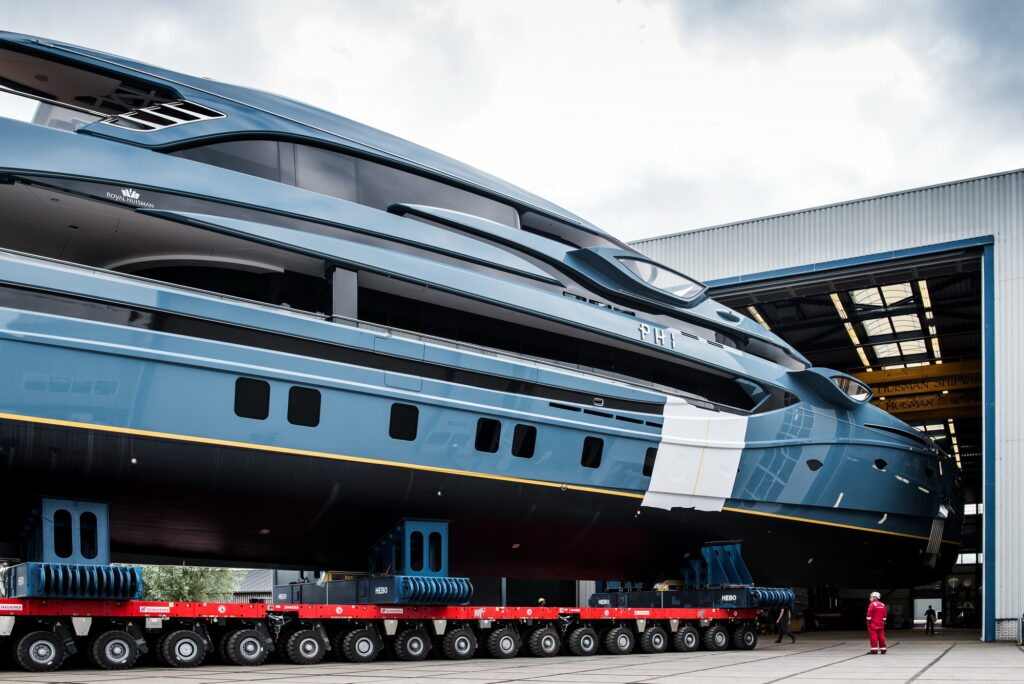 Royal Huisman's project PHI being transported from warehouse on wheels