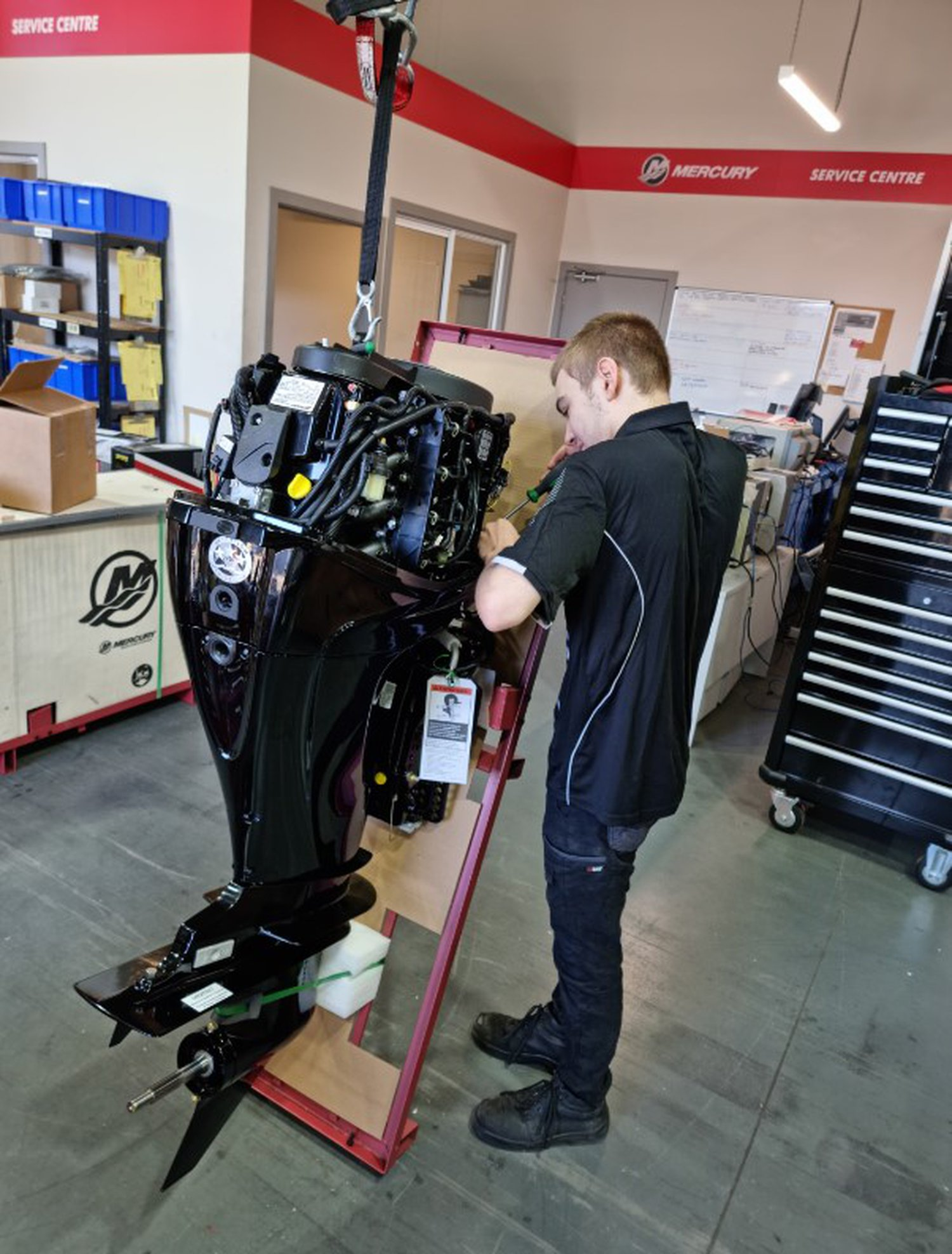 young apprentice working on a Mercury engine in the Mercury Marine academy