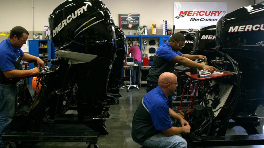 mechanics working a tthe Mercury Marine academy in Victoria