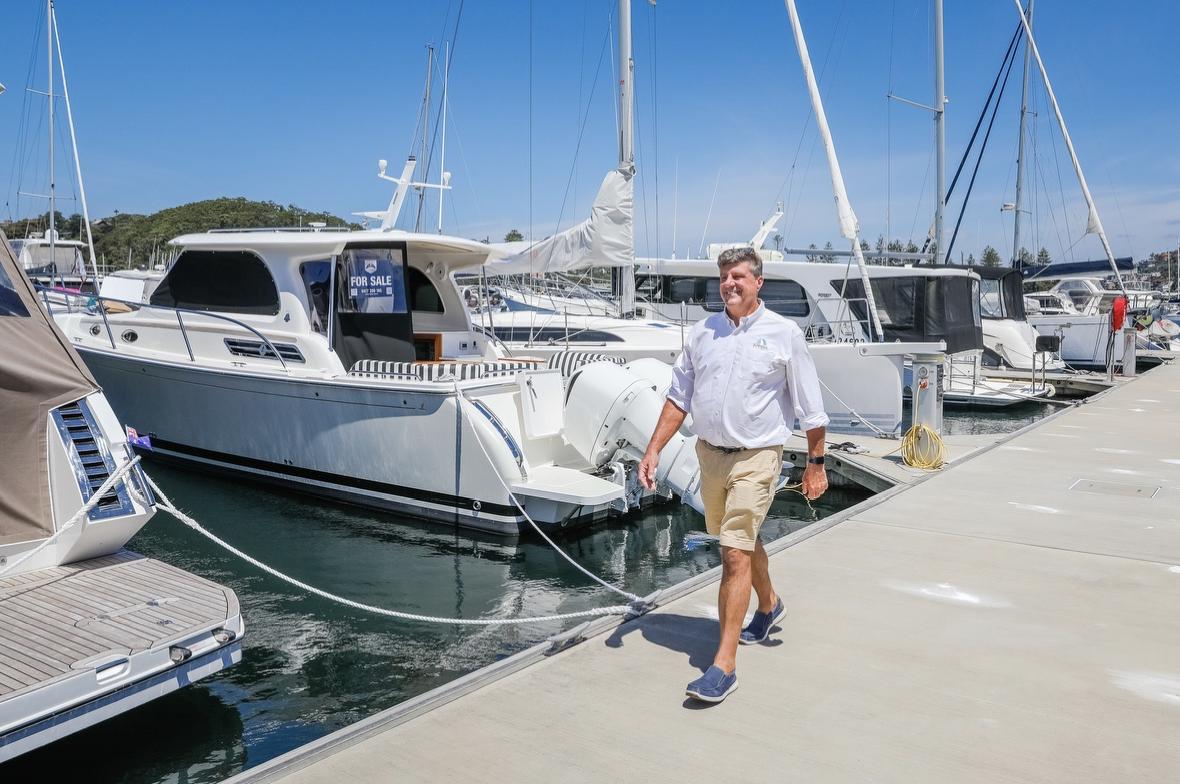Jed Elderkin of E Marine Motor Yachts walking at the Marina