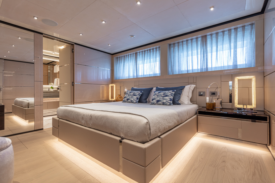 angle of the master bedroom onboard COlumbus sport yacht with interiors by Videoworks