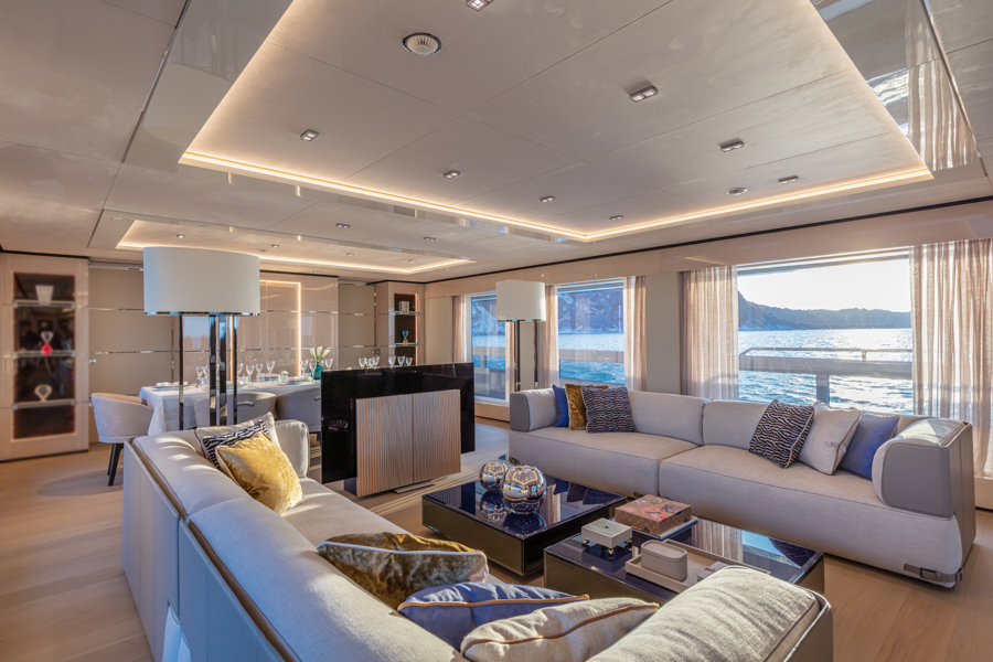 angle of interior living area onboard Columbus sport yacht with interiors by Videoworks
