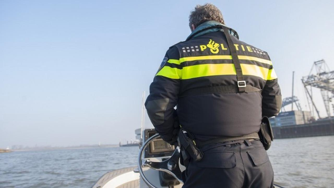 Dutch police officer patrolling on boat