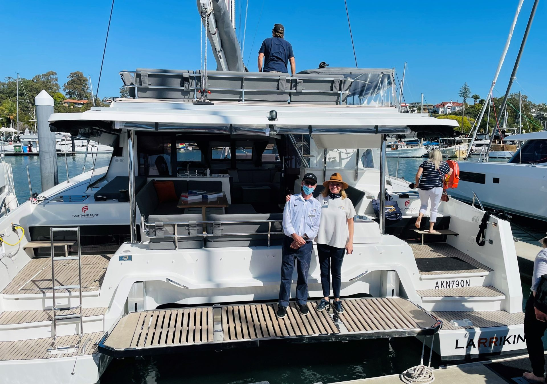 team members fo Multihull Solutions onboard one of their vessels at the Brisbane Yachting Expo