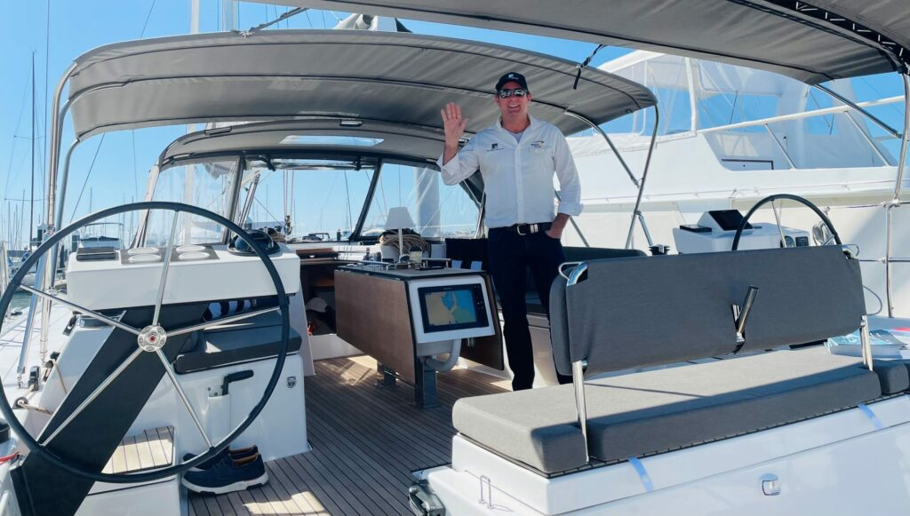 Yacht Sales Co staff onboard one of their vessels at the Brisbane Yachting Expo