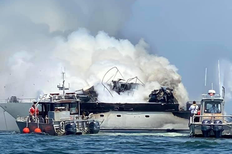 Yacht on fire in the Branford River