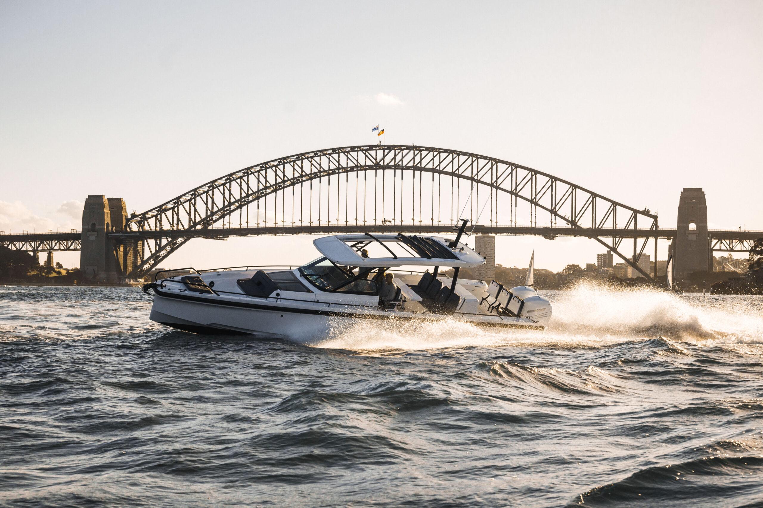 Axopar 37 infront of harbour bridge