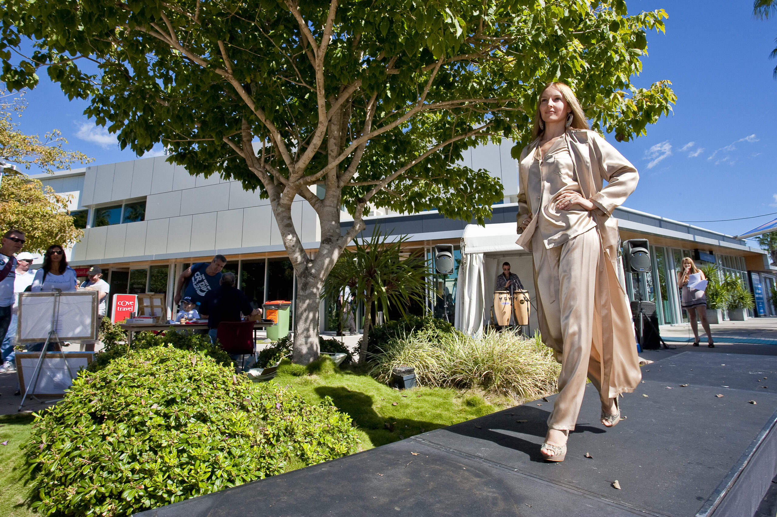 woman walking down the street during Sanctuary Cove Fashion Show