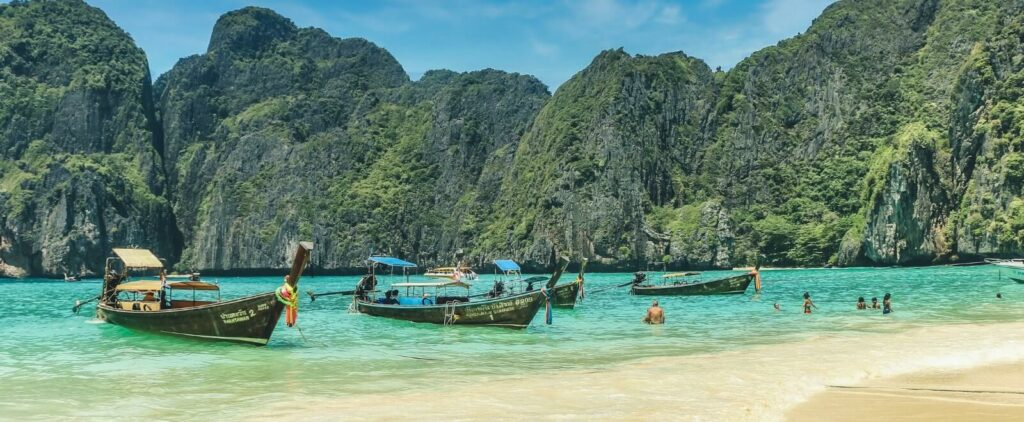traditional boats on the shores of Koh Phi Phi