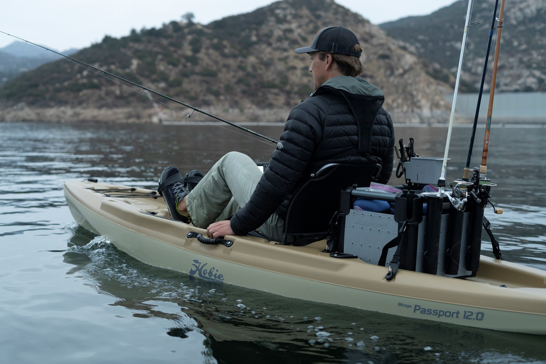 guy fishing in kayak on body of water