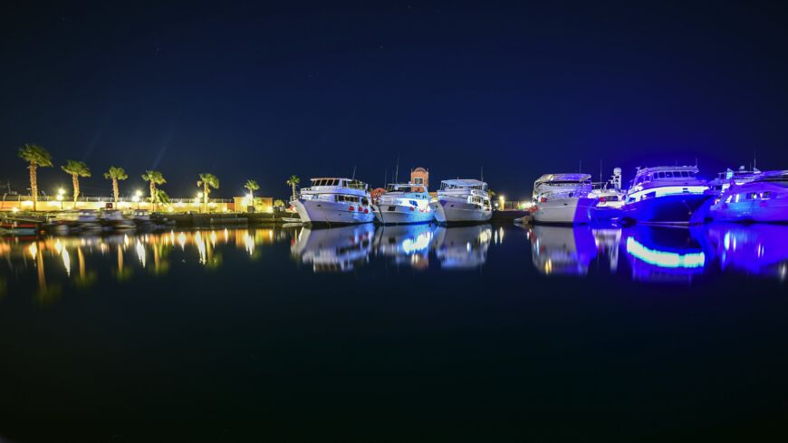 motor yachts docked in Egypt at night time