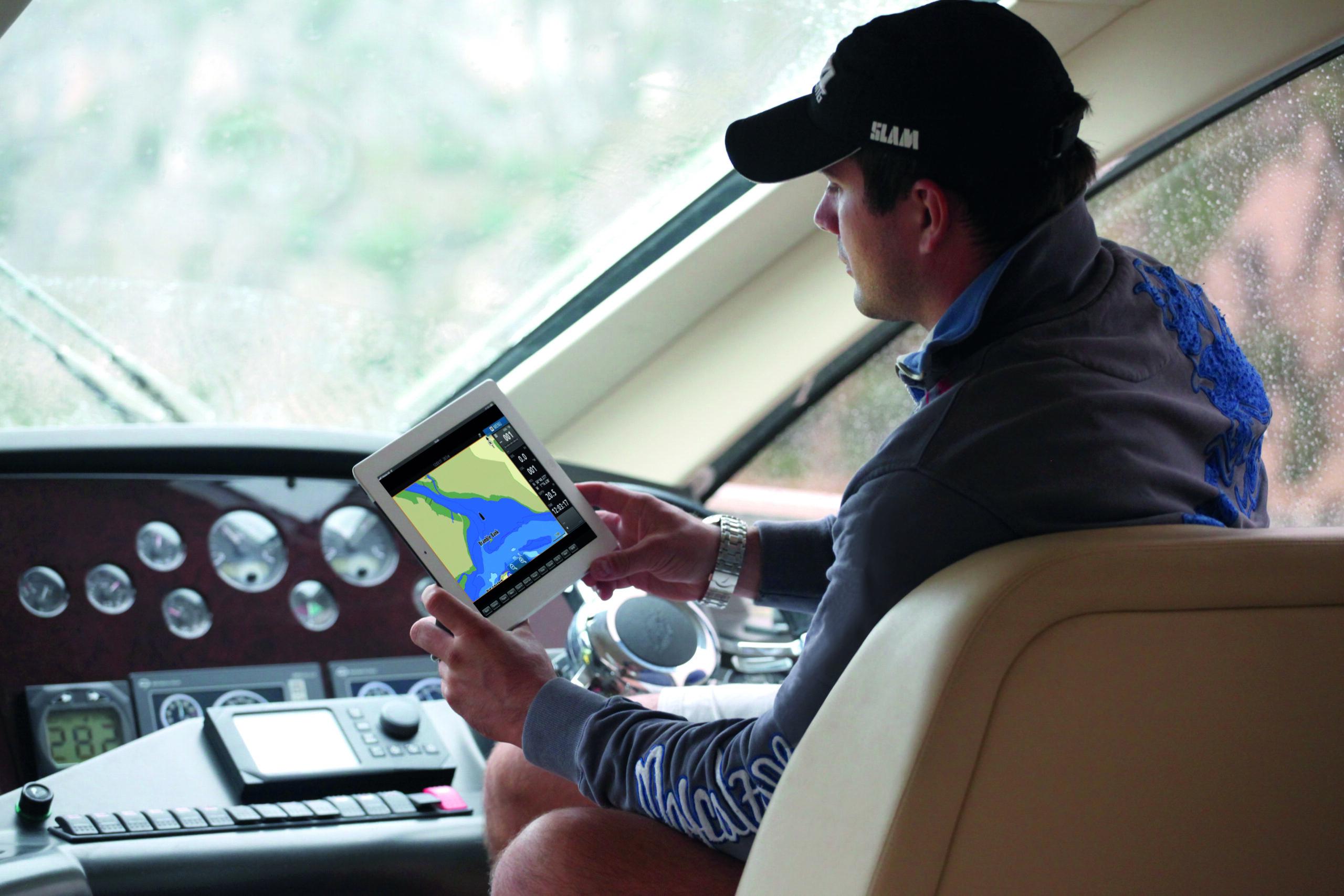 Guy using B&G app onboard a motoryacht