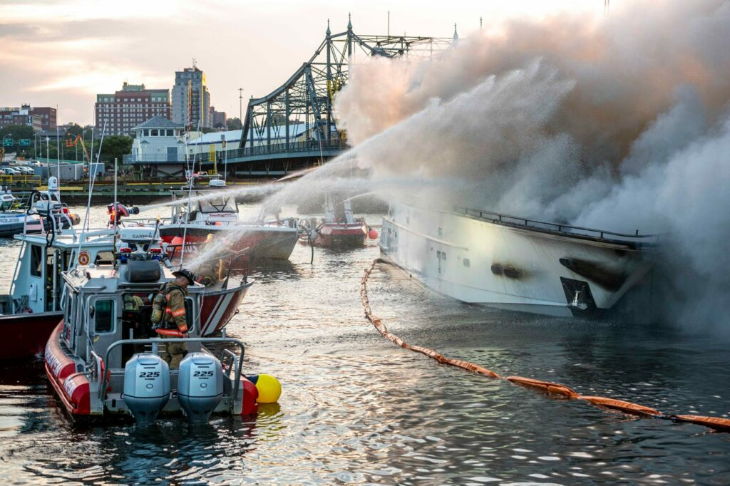 Yacht fire at New Bedford being extinguished