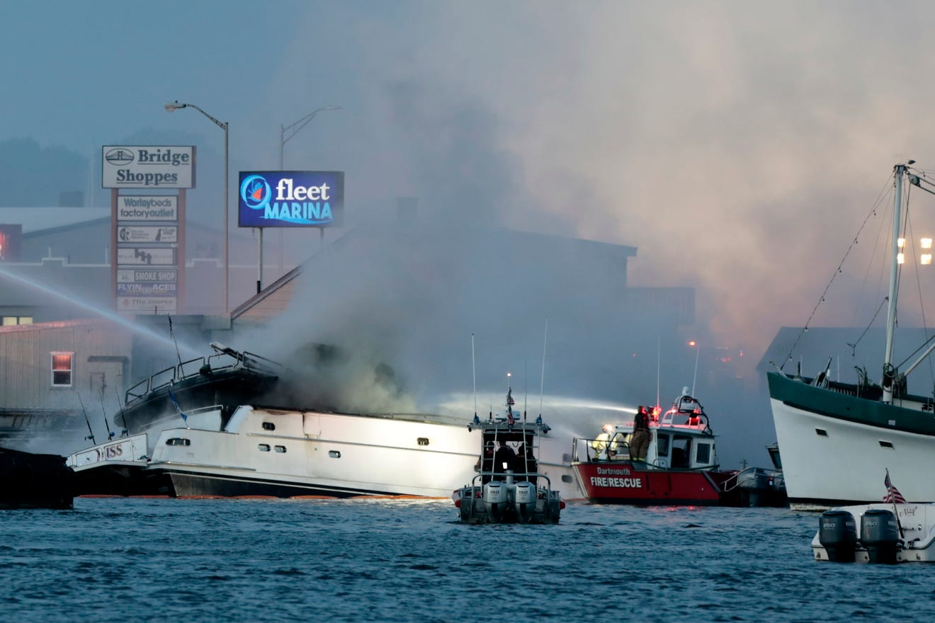 large yacht on fire at New Bedford