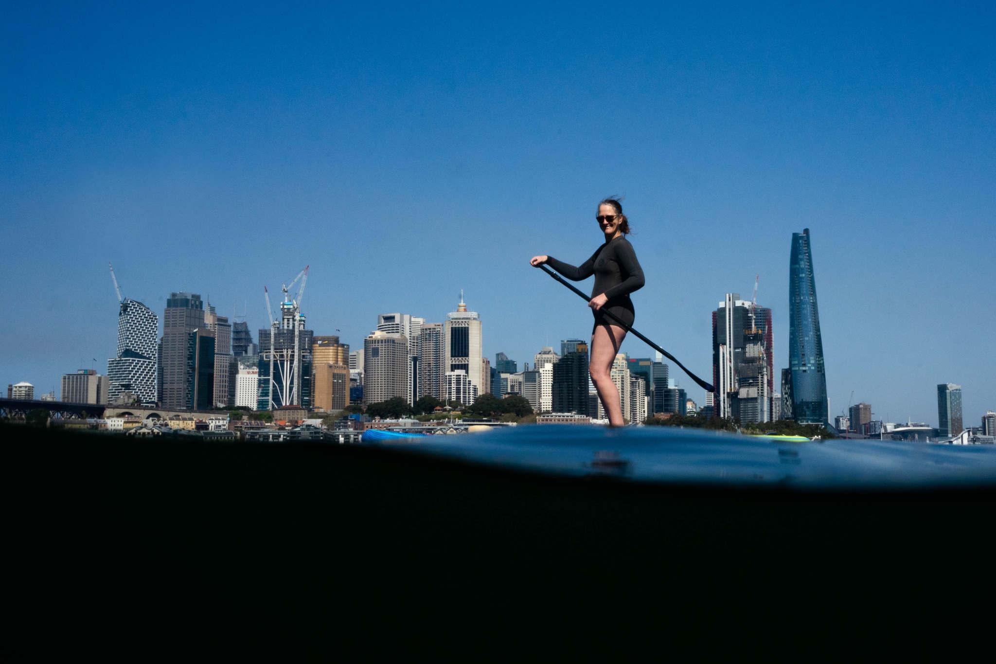 woman paddleboarding in Sydney harbour near Waverton