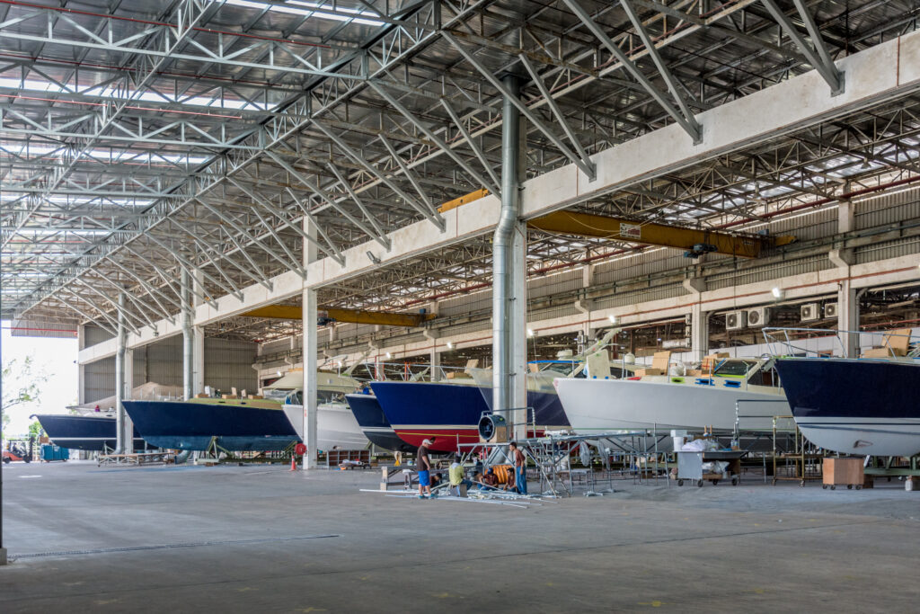 Boats lined up inside the Grand Banks factory