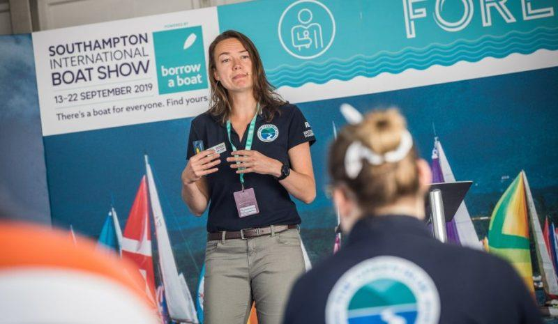 Woman speaking about single use plastic at the Southampton Boat Show