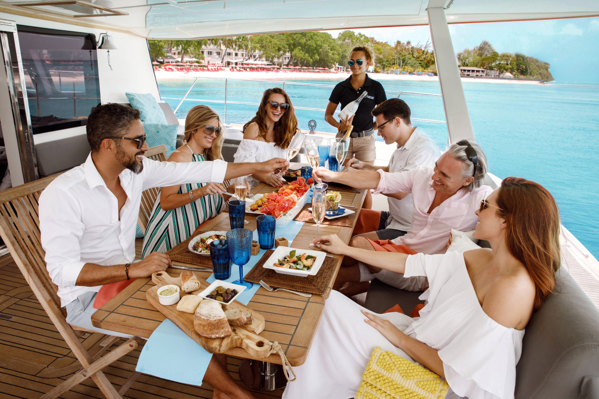 Family dining onboard an Aquila power catamaran