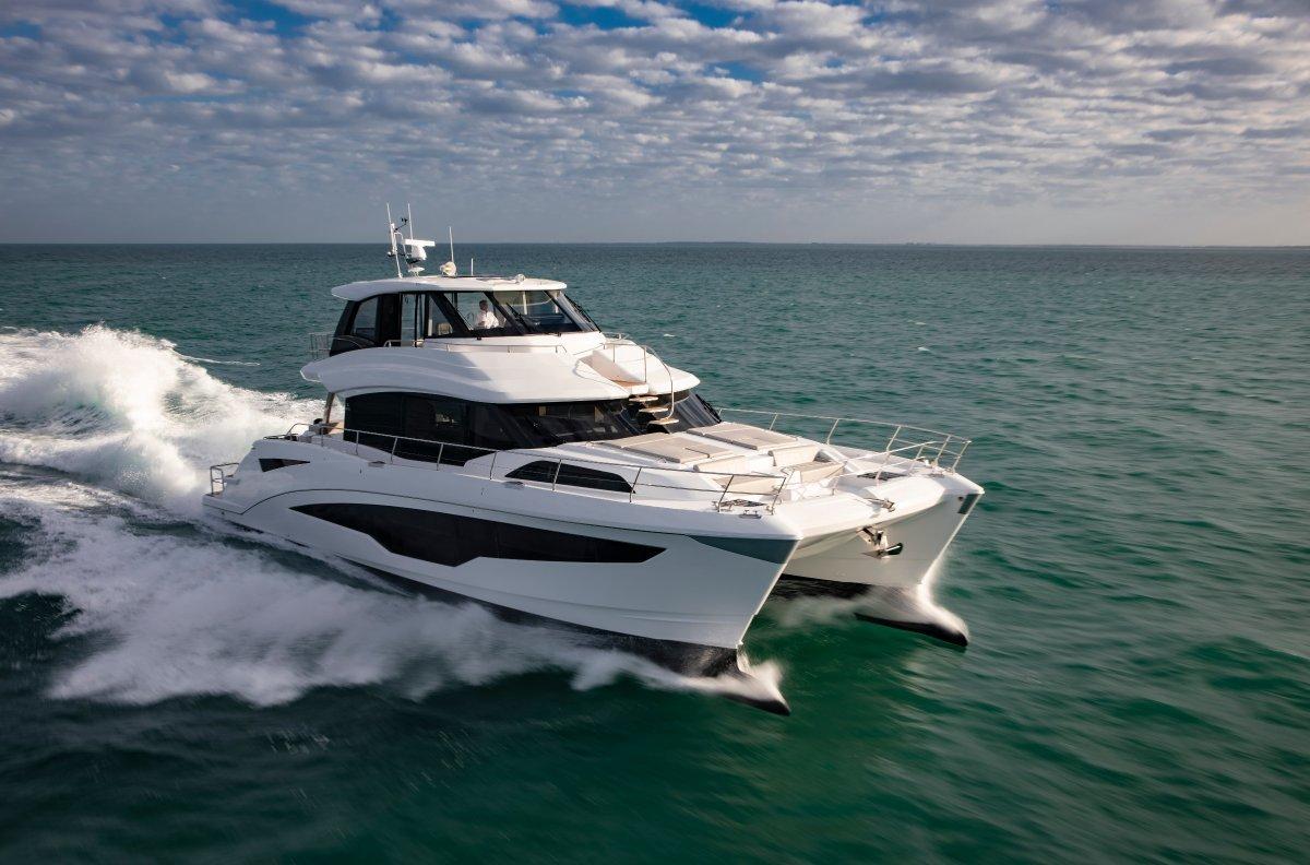 Aquila 70 power catamaran cruising at speed