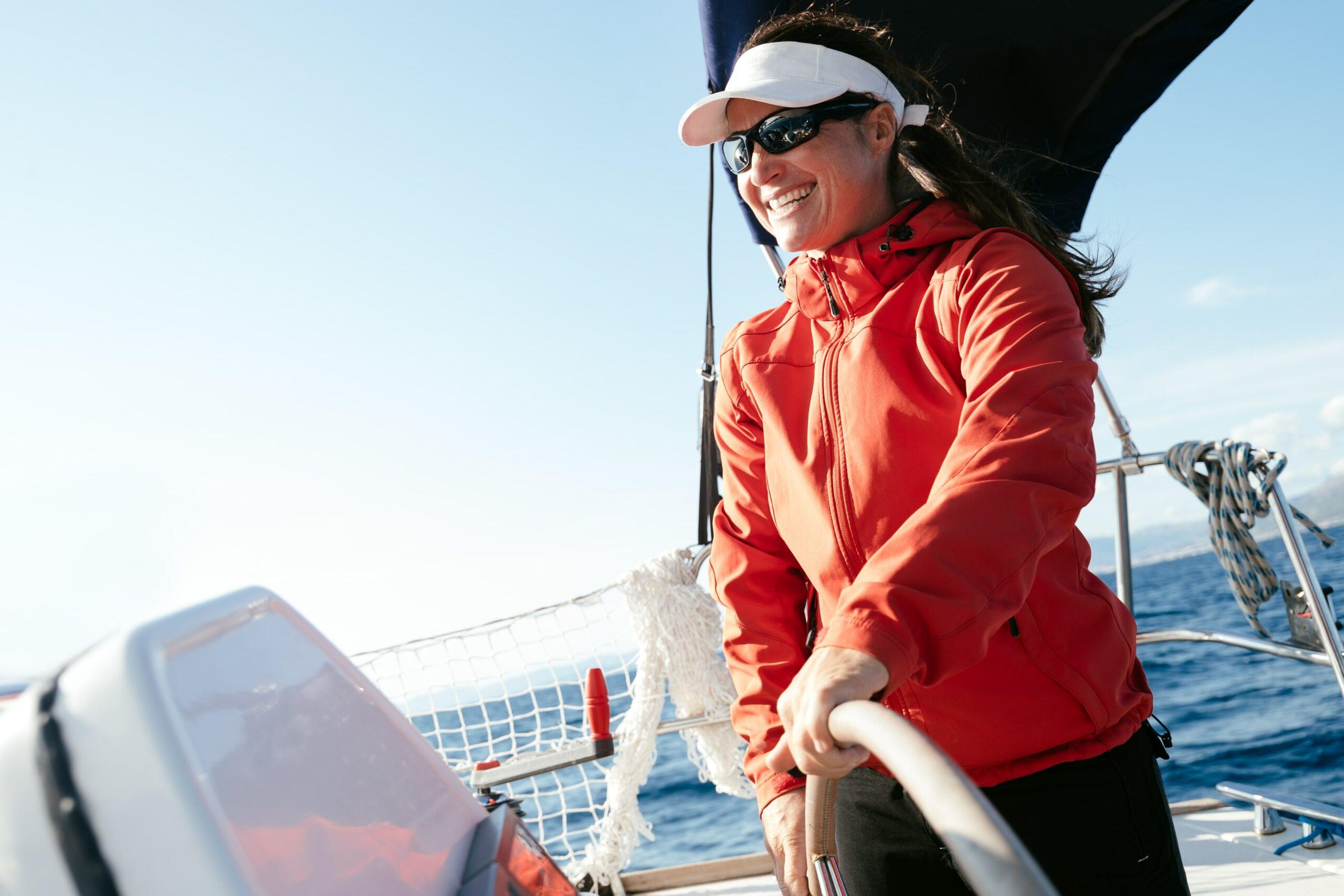 Woman sailing and smiling