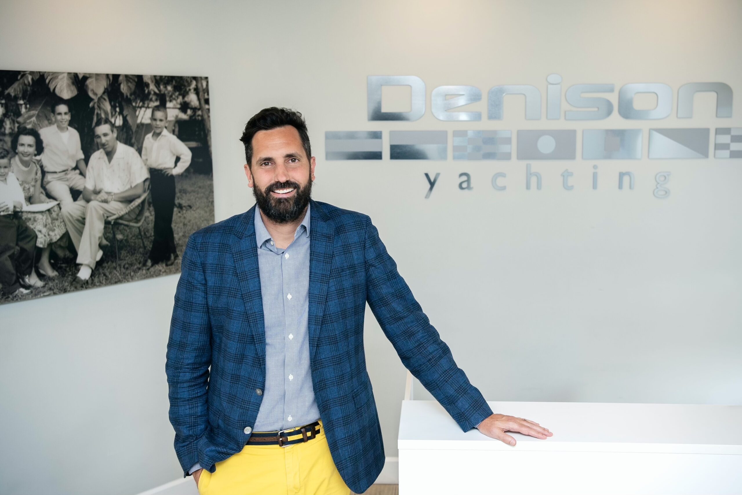 Bob Denison in front of Denison Yachting sign
